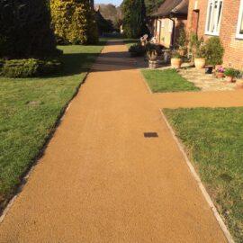 Buff coloured tarmac pathways in Walton-on-Thames, Surrey